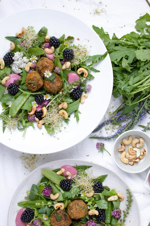 Wild Herb Salad With Lentil Köttbullar, Berry Dressing & Cashew Crunch