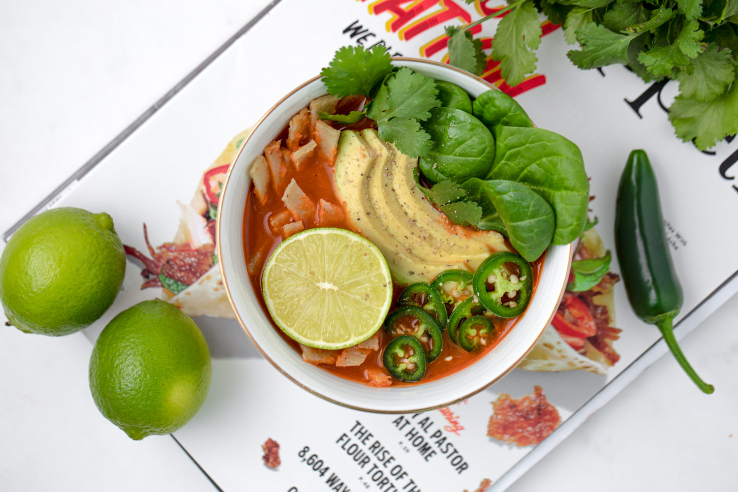 Classic Mexican Tortilla Soup from Above with avocado, lime and cilantro By Karolin Baitinger