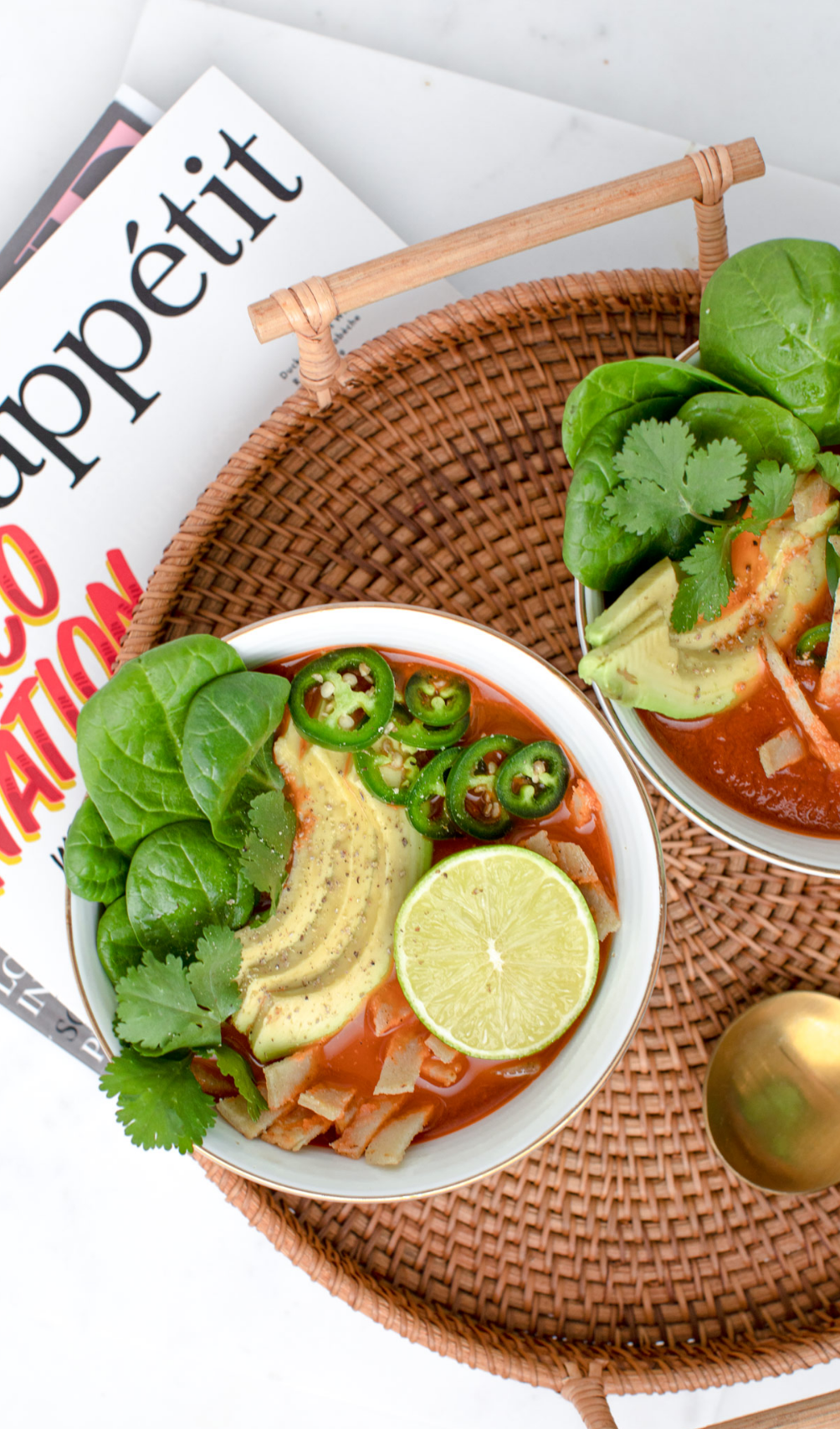 Mexican Tortilla soup with avocado, lime and cilantro by Bakd&Raw